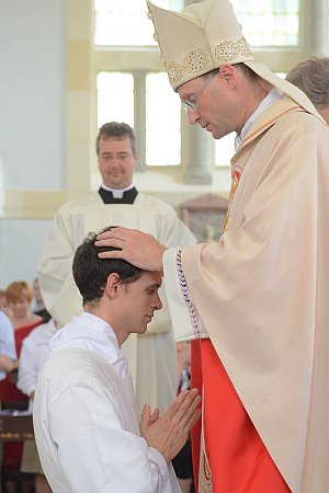 Bishop lays his hands on Joseph Bolin's head